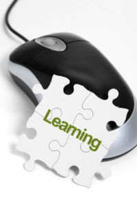 computer mouse and Puzzle, business concept of Learning